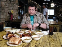 Adam Richman, about to take on one of the many food challenges in the show.
